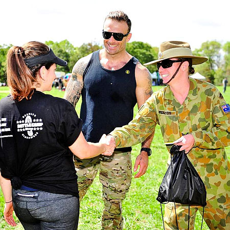 (R-L) Corporal Megan Polatos from Defence Force Recruiting and Commando Steve congratulate a participant on her effort during the 90-minute fitness session in Canberra on February 22.
