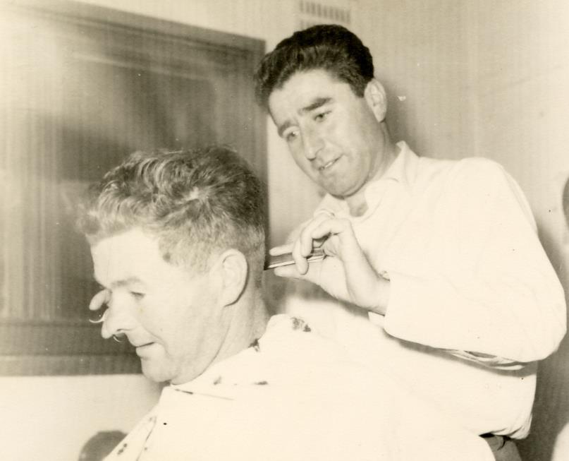 Guiseppe Cataldo cutting a clients hair circa 1960s