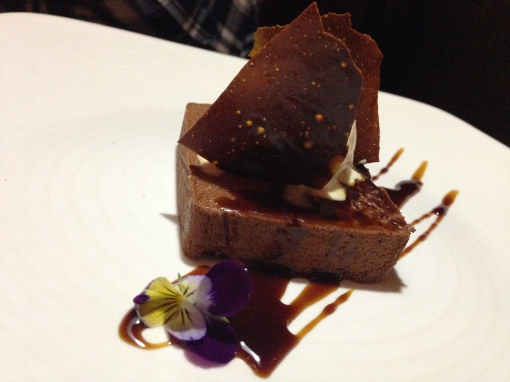 Valrhona Chocolate Pavé with white coffee bean ice cream and espresso syrup.