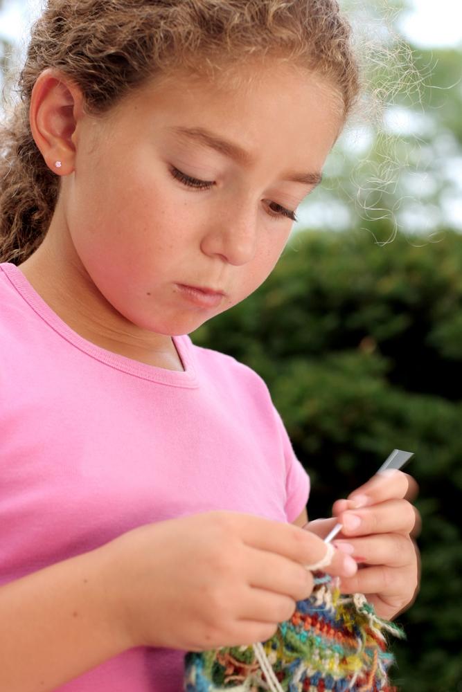 Girl knitting - image from Shutterstock.com