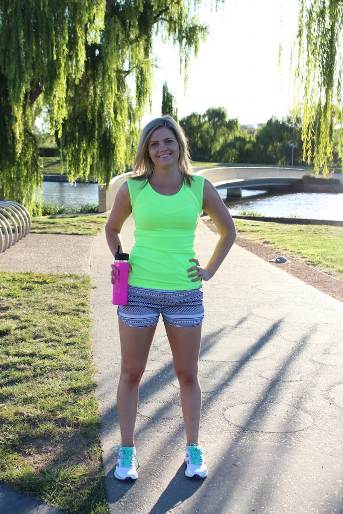 Summer S/Slv Excel Top $65.99, Deco Bra (worn underneath), $65.99. Existence Run Short, $65.99, Iconic Glass Water Bottle, $35.99