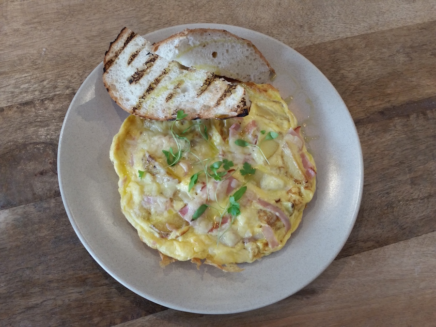 Three egg frittata with ham, roasted potatoes and pecorino cheese