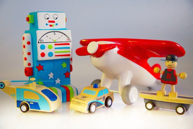 Products (left to right) are Wooden Helicopter $17.95; Robot $29.95; Wood Police Car $15.95; Red Aeroplane $45.00; and Wooden Skateboarder $17.95.