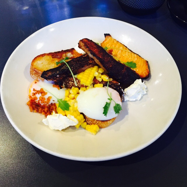 Slow cooked eggs, crispy smoked salmon, creme fraiche, corn and charred bread ($19)