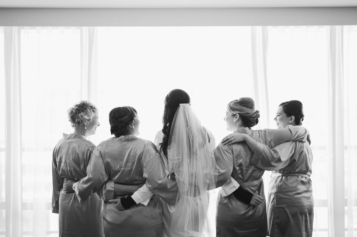 Laura getting ready with her bridesmaids and mum.