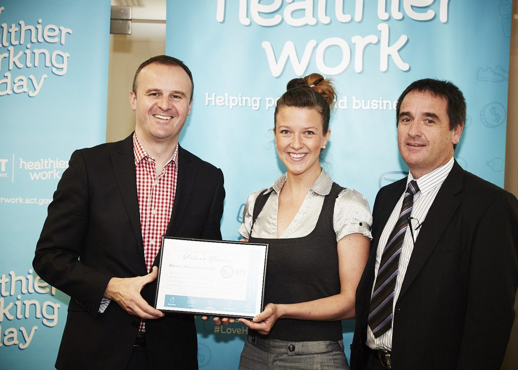 Long time Foundation Patron & activity ambassador ACT Chief Minister Andrew Barr presenting a Silver Healthier Work ACT Award to local engineering experts Barmco Mana Partnership