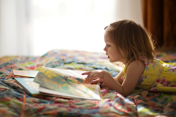 little girl reading feature