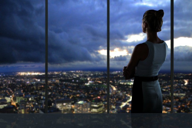 woman looking at city feature