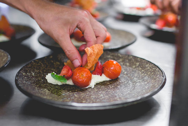 Pod Food's entrée of Mum's cherry tomatoes, roast strawberries, local cow curd, basil.