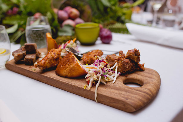 The One's Shared Meat Platter: slow cooked crispy pork neck and beef chuck, crispy sous vide chicken wings, Thai slaw, charred sweet American bread with BBQ, chilli, garlic and sumac emulsion and guacamole.