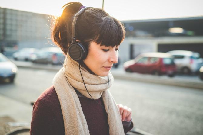 woman walking listening feature