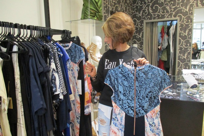 Sarah Kelly selecting the clothes at Momento Dezigns