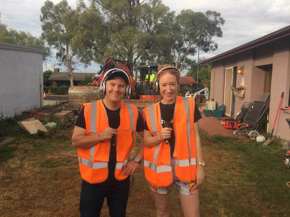Kristen and Rod broadcasting from the construction site