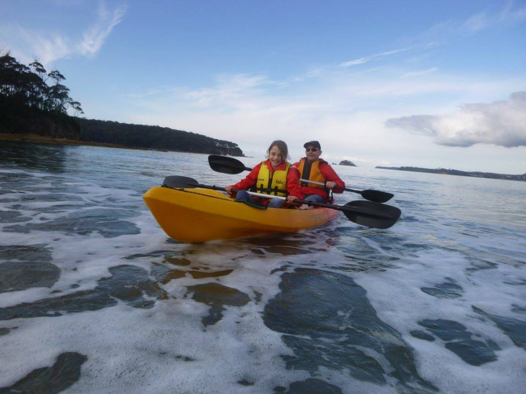 Miss Eight and Mr HerCanberra enjoying their glass bottom kayak tour. Photo: Region X Kayak Experiences.