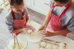 Mother and daughter are cooking