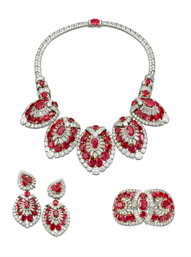 Cartier Paris. Necklace, bracelet and pair of earrings 1951, platinum, gold, brilliant-, baguette-, modified baguette- and fancy-cut diamonds, cushion-shaped and round faceted Burmese rubies 37 cm (l. necklace); 6.2 cm (l. bracelet at c.); 6 cm (l. earrings). Collection Cartier © Cartier. Photo: Marian Gérard.