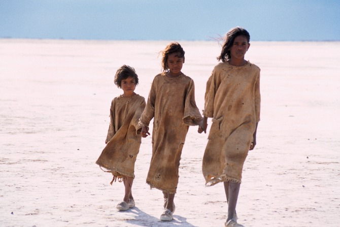 Rabbit-Proof Fence - Tianna Sansbury, Laura Monaghan and Everlyn Sampi as Daisy, Gracie and Molly traversing a salt pan by Matt Nettheim.