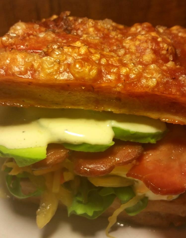Pork Belly Burger - bacon, fermented vegetables, avocado lemon aioli, sweet potato galette.