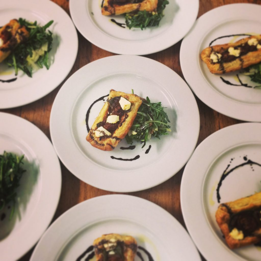 Caramelised onion & Meredith goat cheese galette with pear & rocket salad
