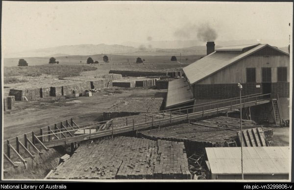 Bricks stacked at the Canberra Brick Works, Yarralumla by Harry Connell, courtesy of National Library of Australia. Part of the collection: Photographs of the construction of Canberra, 1913-1917.