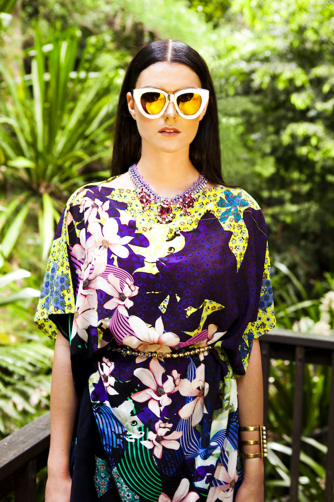 Dress, $659, and necklace (used as belt), $219, both by Megan Park at Pink Inc; sunglasses, $399, by Karen Walker at Pink Inc; bangle, $159, by Sylvie Markovia at Pink Inc; necklace, at Pink Inc.