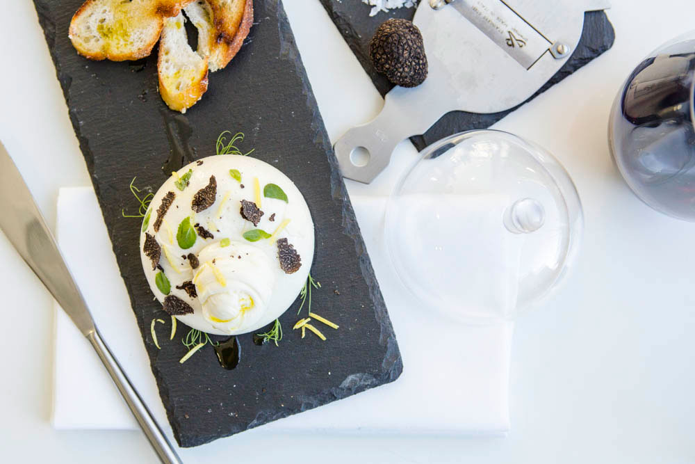 Smoked Burrata with shaved local truffle, EVOO and crusty bread. Photo credit: Nathan Lanham.