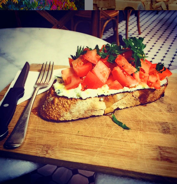 Freshly baked sourdough with ricotta, tomato and fresh herbs.
