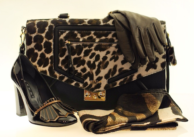 Products (left to right) Pumps $375.00; Handbag $1,100.00; Silk Scarf $50.00; Gloves $99.00.