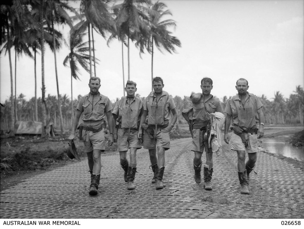 Milne Bay, Papua. 1942-09. Pilots Of No. 75 Fighter Squadron Raaf Going Out On A Strafing Raid. Left To Right:- Flying Officer B. D. Watson, Sergeant Norman, Sergeant R. G. Riddell, Flight-Lieutenant Archie Hall, And Pilot- Officer A. J. Gould. Note The Steel Matting. Courtesy of the Australian War Memorial