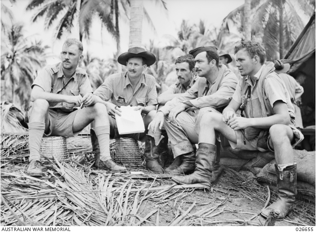 Milne Bay, Papua. 1942-09. Fighter Pilots Of The Raaf Standing By At Their Airfield. Left To Right:- Pilot Officer Bruce Brown; Squadron Leader L. Jackson, 75 Squadron; Flight Lieutenant V. Sullivan, 76 Squadron; Flight Lieutenant L. Winton, Sergeant R. G. Riddel, 75 Squadron. Image courtesy of the Australian War Memorial.
