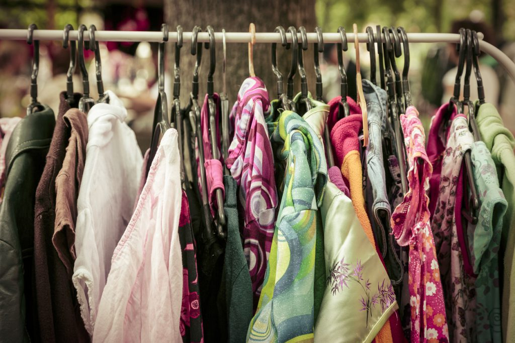 clothes on a rack on a flea market