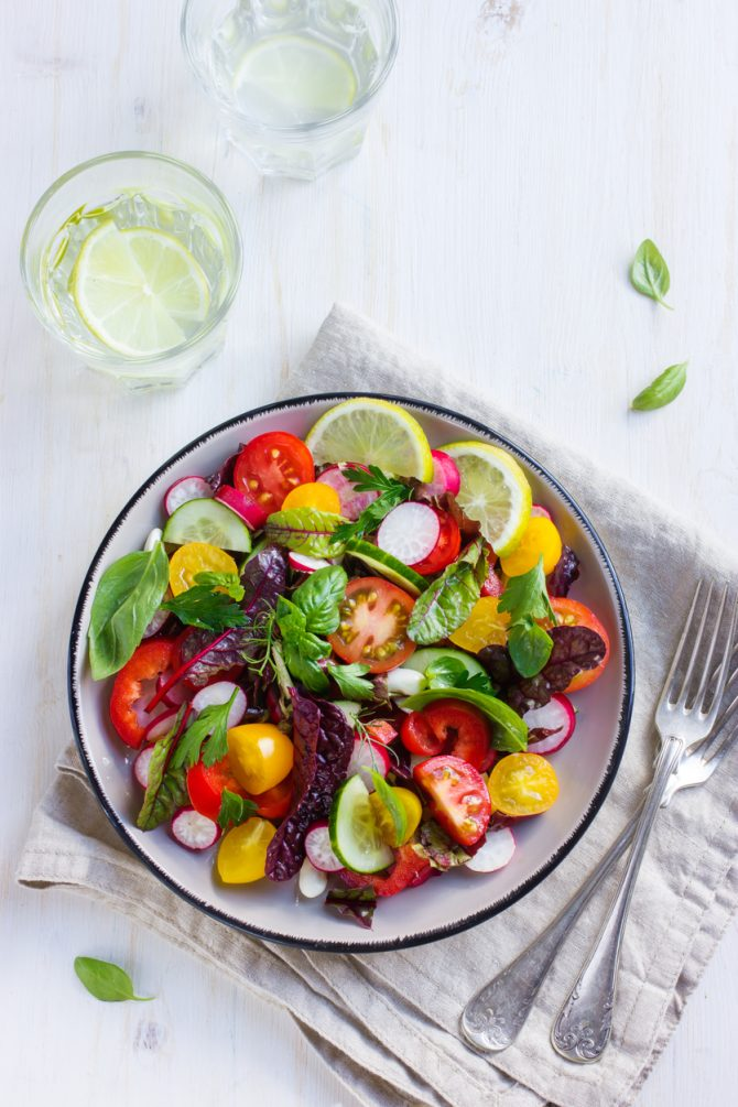 Salad with fresh summer vegetables, top view